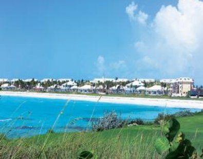 Mile long crescent beach is its own rewarding destination.