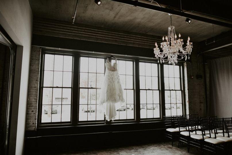 Wedding dress by the windows