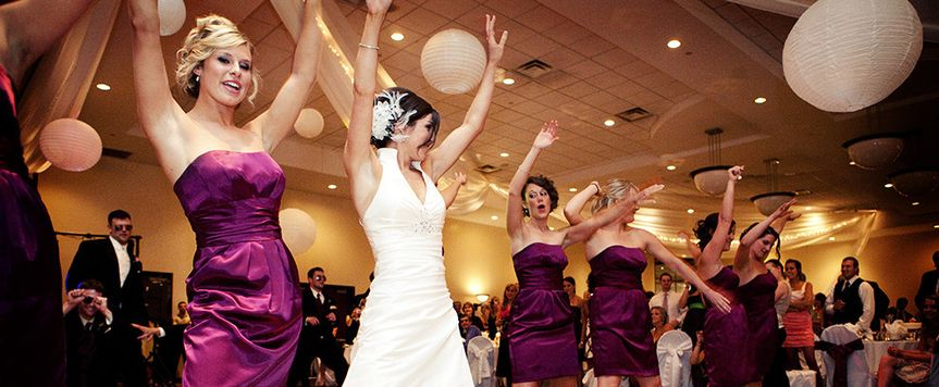 The bride with her bridesmaids dancing