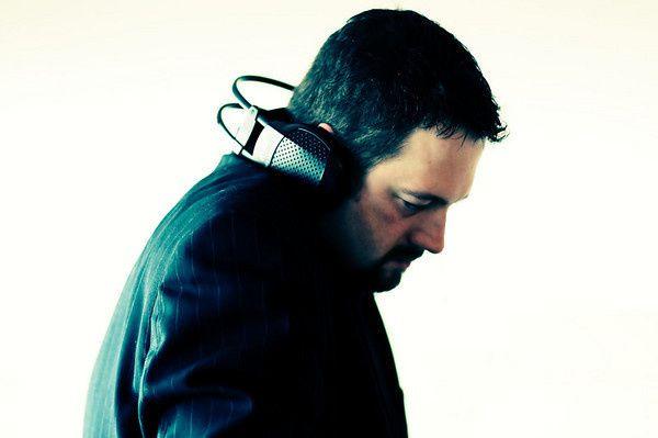 Tmx 1466991941364 Dk In Suit With Headphones Mixing Seattle wedding dj
