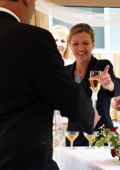Serving Champagne at an Enchanted Elopement package offered by Radiant Touch Weddings in Oregon...