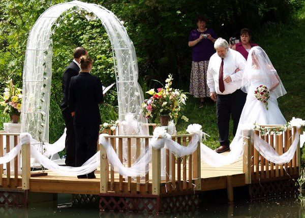 Ceremony on the dock, country location, decorations, photography, canopy, champagne toast ALL...