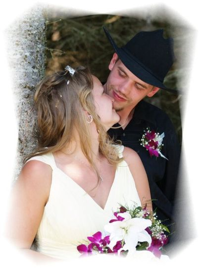 A western style wedding. Men in Carharts, bridesmaids in jeans and halters.