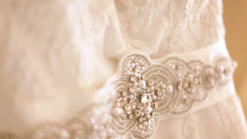 Beautiful tight shot of the beading on Barbara's wedding dress.