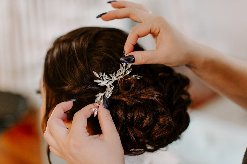 Wedding updo with white hair accessory