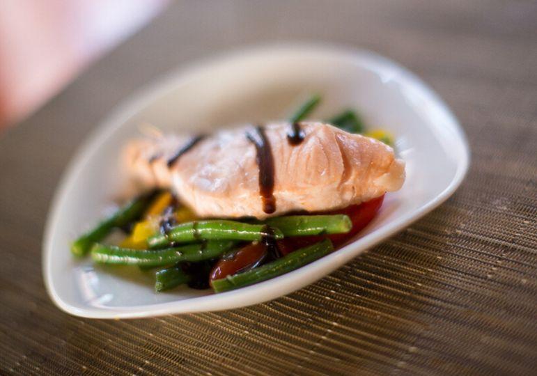 Seared salmon over tomato and