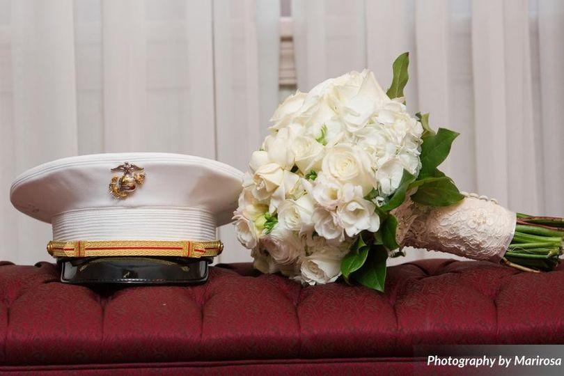 Groom's hat and bride's bouquet