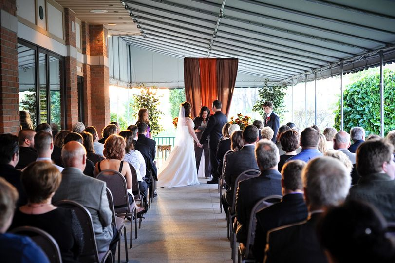 This is an outdoor wedding w/canopy attached to Country Club building. It's perfect because it...