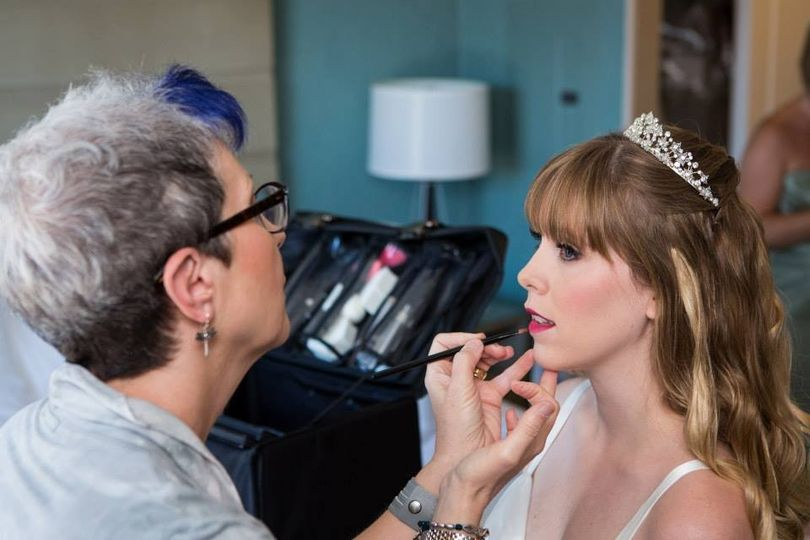 Putting lipstick on