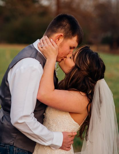bride and groom, kiss, outdoors