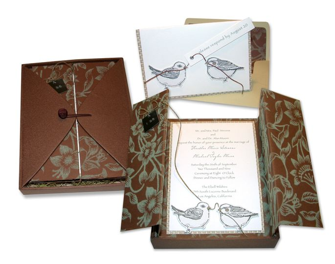 Love Birds: Custom-made paper-covered boxes with flaps and woven-button closures serve as the...