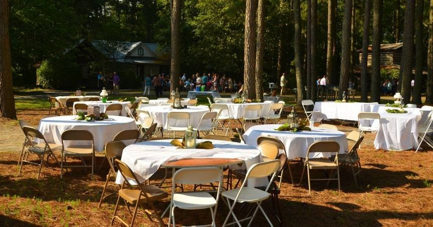 Reception tables set up under the pines
