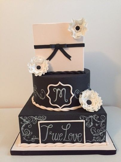 Three tier black and white cake