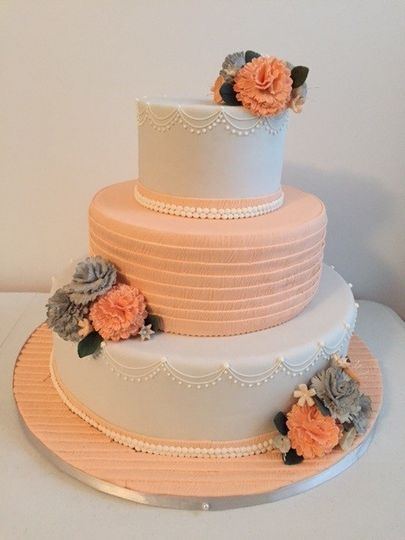 Three tier white and orange cake