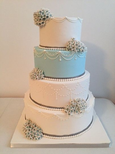 Four tier white and blue cake