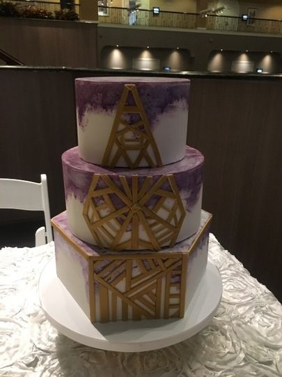 Three tier white and purple cake