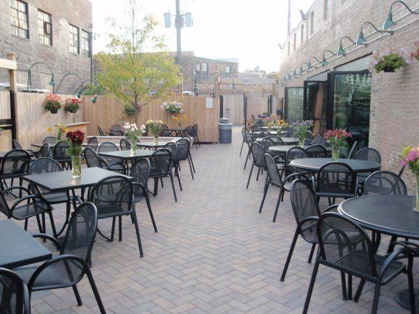Outdoor patio set for wedding reception.