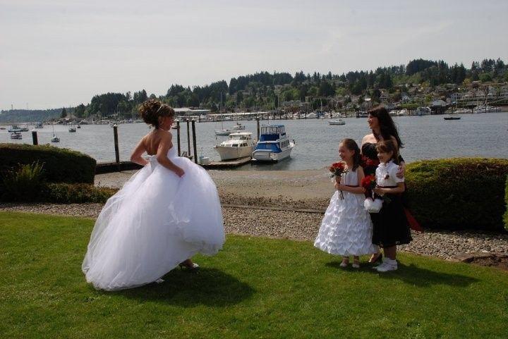 Bride walking towards the flower girl