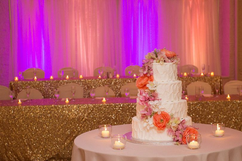 Candlelit head table and cake table