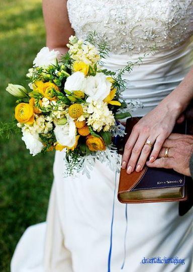 Bridal bouquet of ranunculus, lisianthus, freesia, stock and crespedium.  Photo by Dramatic Imaging.
