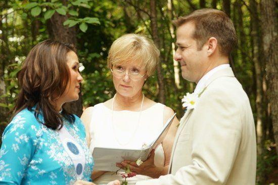 Rev. Lodge, Jenny and Brandon, back yard wedding