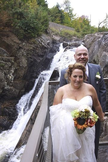 Couple and waterfall behind