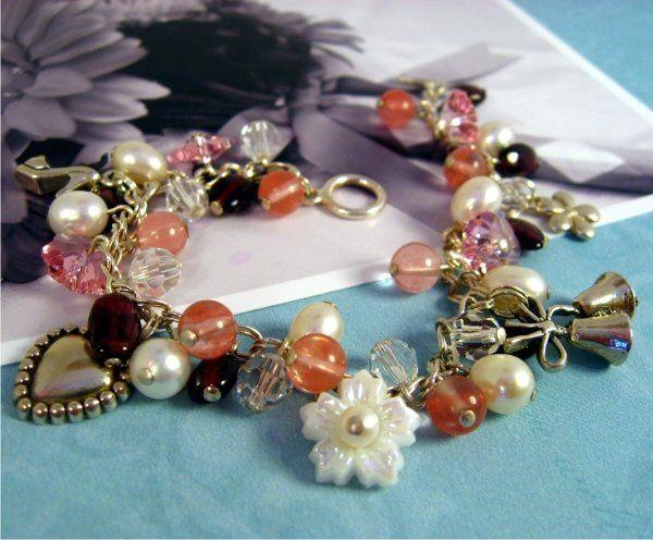 Freshwater pearls, Swarovski crystals, cherry quartz and garnet gemstones.  Sterling silver bridal...