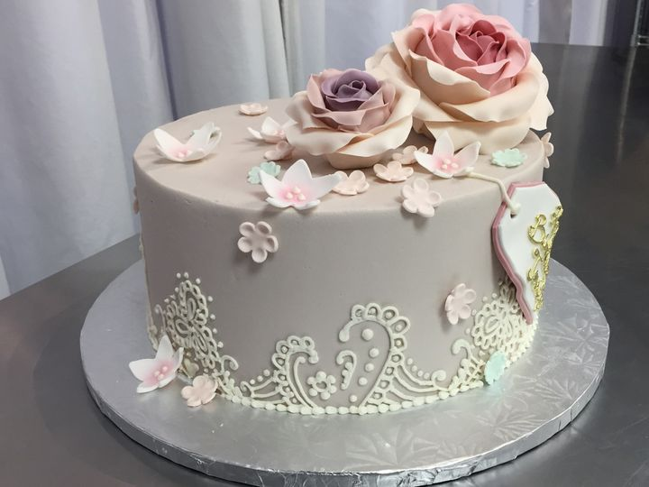 Stunning gray lavender cake with hand piped lace