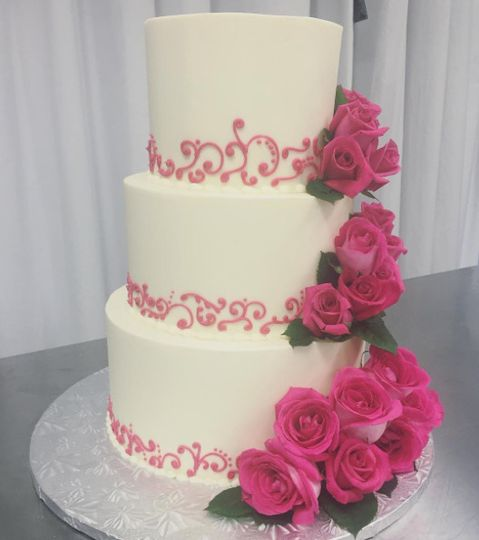 Three tier cake with rose decorations