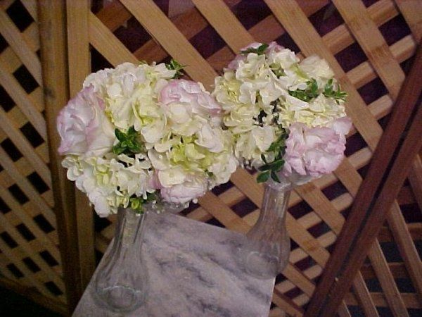 Modest size bridesmaids bks. A sweet  combination of white hydrangeas, pink and white sweetheart...