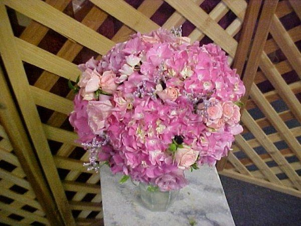 Lush pink hydrangeas, pink lisianthus, pink sweetheart roses make a brite pink statement in this...