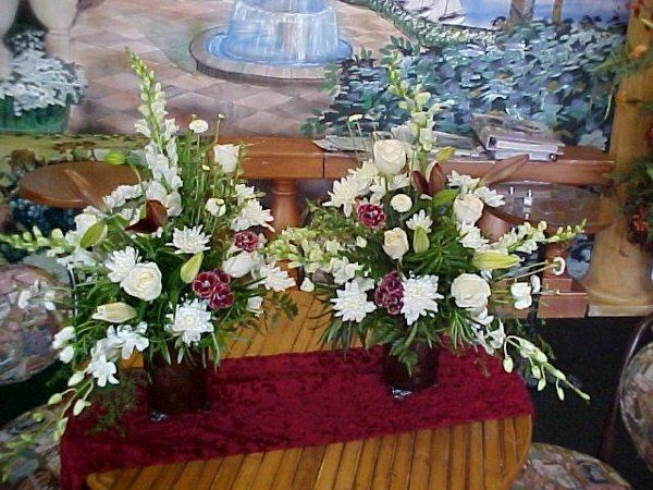 A pair of all whites for the ceremony altar.