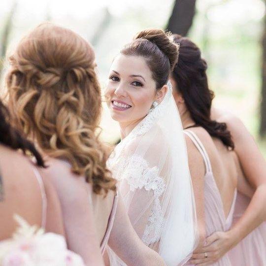 rachel face with bridesmades back