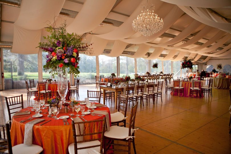 Orange tables and raised floral centerpiece