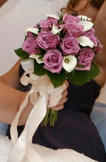 White Calla lilys,Bluebird Lavender Roses & with cream satin bow.