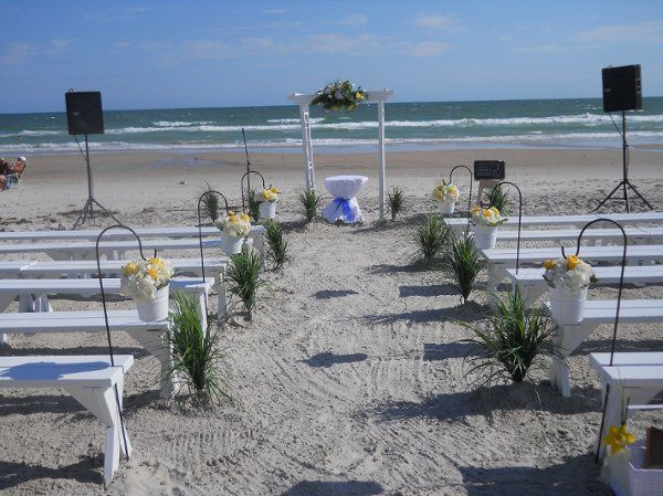 Topsail Island Wedding with White Arch,White Benches,Shepard Hooks with Buclets of white Hydragnes &...