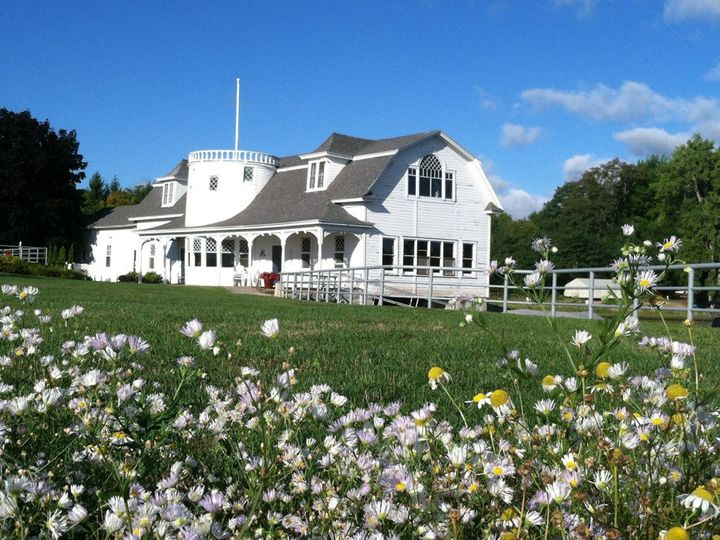 Tmx Baothouse From Lake With Flowers In Front 51 569668 Peru, NY wedding venue