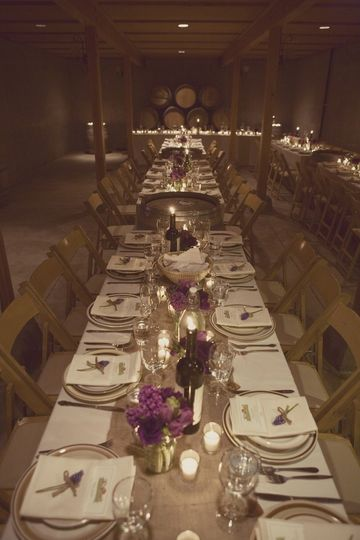 Long table setting with floral and candle centerpiece