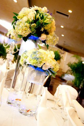 Beautiful flower arrangement per table inside the banquet hall. Colors complimented the accessories...