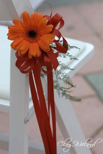 It's the little details that count. Each chair during the wedding reception was adorned with a...