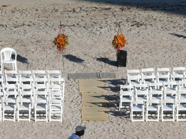 A wedding on the beach, guests got to enjoy the bride and groom making their vows while enjoying the...