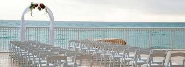 Pool deck wedding set up. Simple elegant arch that was catching the wind perfectly. Chairs were...