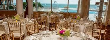 The wedding happened outside on the pool deck that oversaw the beach and ocean waves. An intimate...