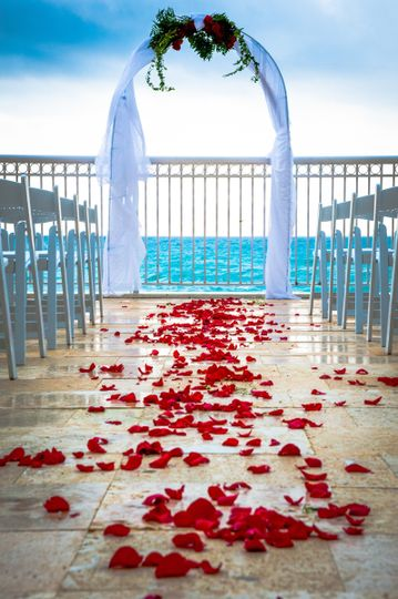Wedding Reception Arch overlooking the ocean from the pool deck of our beach resort.
