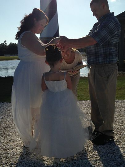 Officiant greeting the flower girl