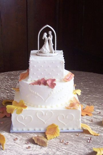 Multi shaped wedding cake with hand made leaves in the color of fall.  A different piped design on...