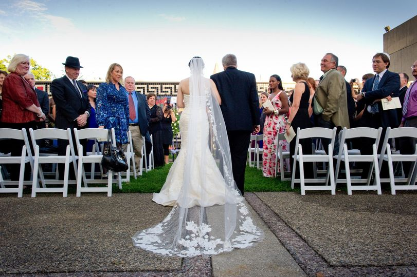 Ceremony in the outdoor Courtyard with the Mosaic and sky as your backdrop