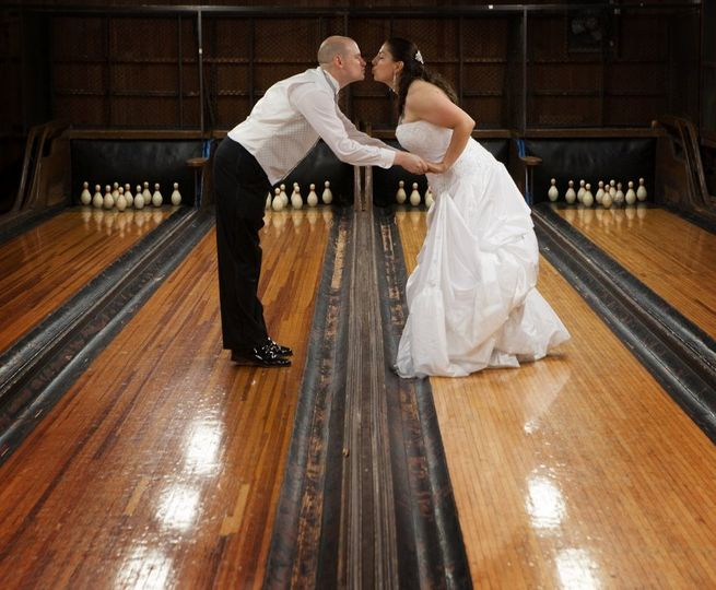 Fantastic beach wedding at a little country club with a bowling alley. I love this shot because to...