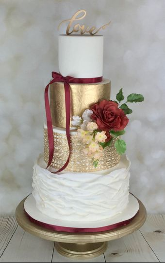 Gold and burgundy with handmade sugar flowers