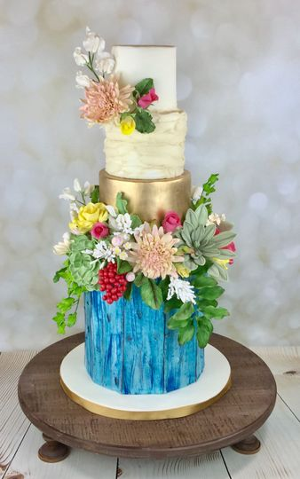 Rustic painted wood cake with sugar flowers